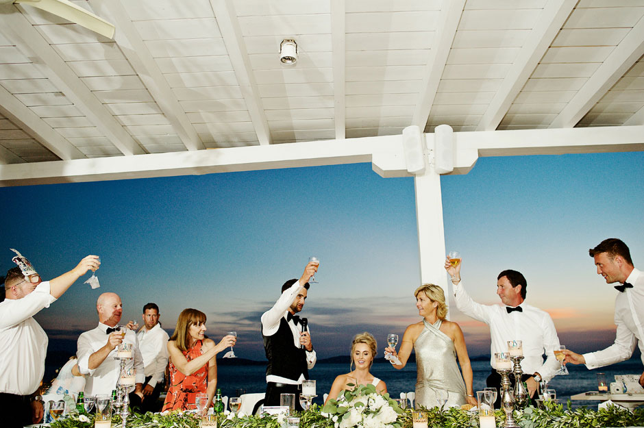 groom make a toast to the bride in mykonos wedding