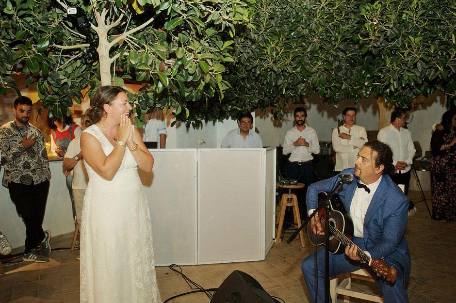 groom plays a song to the bride in naxos wedding