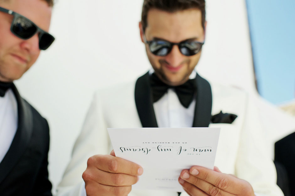 groom reading letter from the bride in mykonos