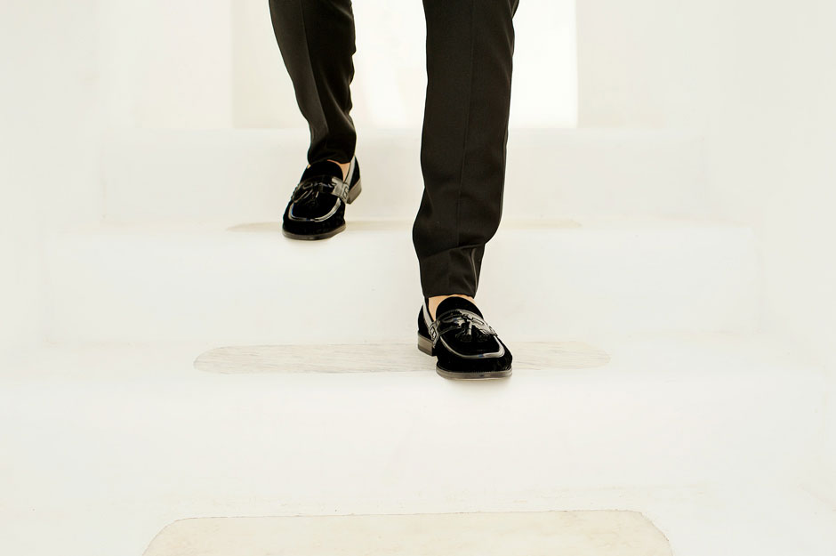 groom walking down the stairs in mykonos hotel