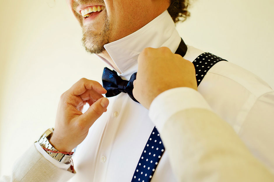 groom wearing a blue bow tie on wedding party