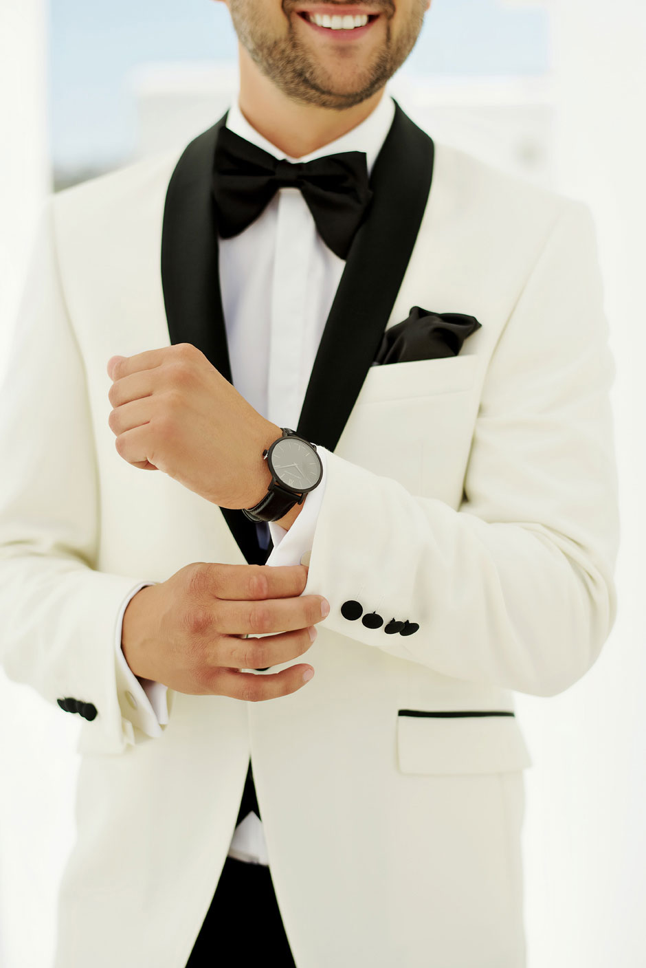 groom white tuxedo black bow tie