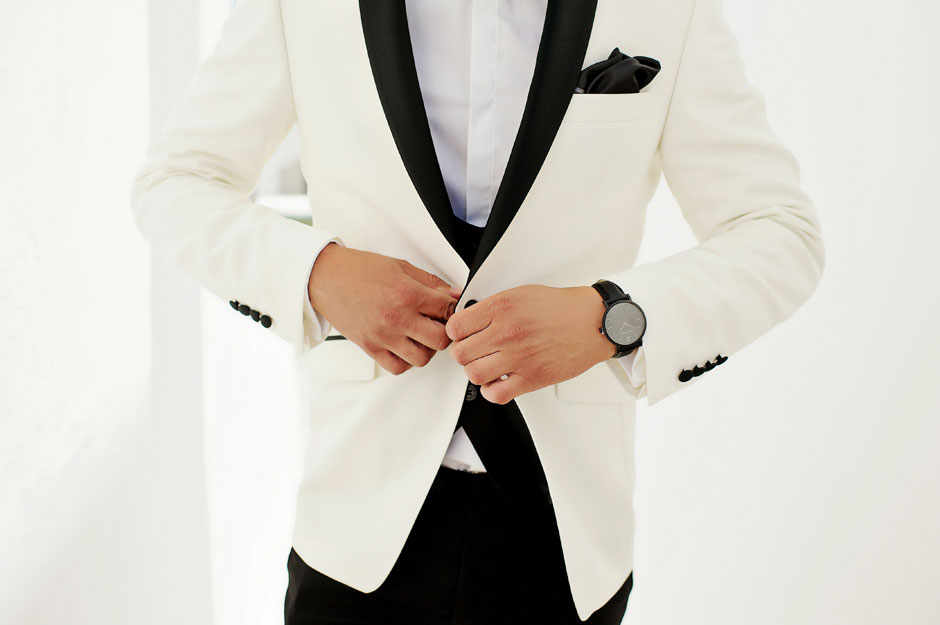 groom wearing white tuxedo
