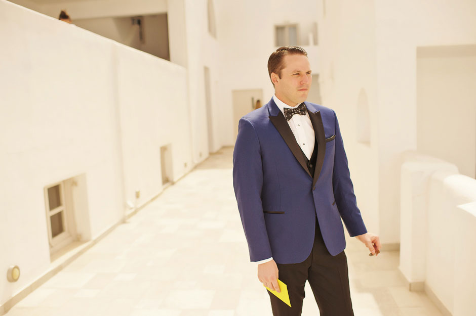 groom-with-blue-tuxedo-waiting-for-the-bride-in-santorini-elopement-day-