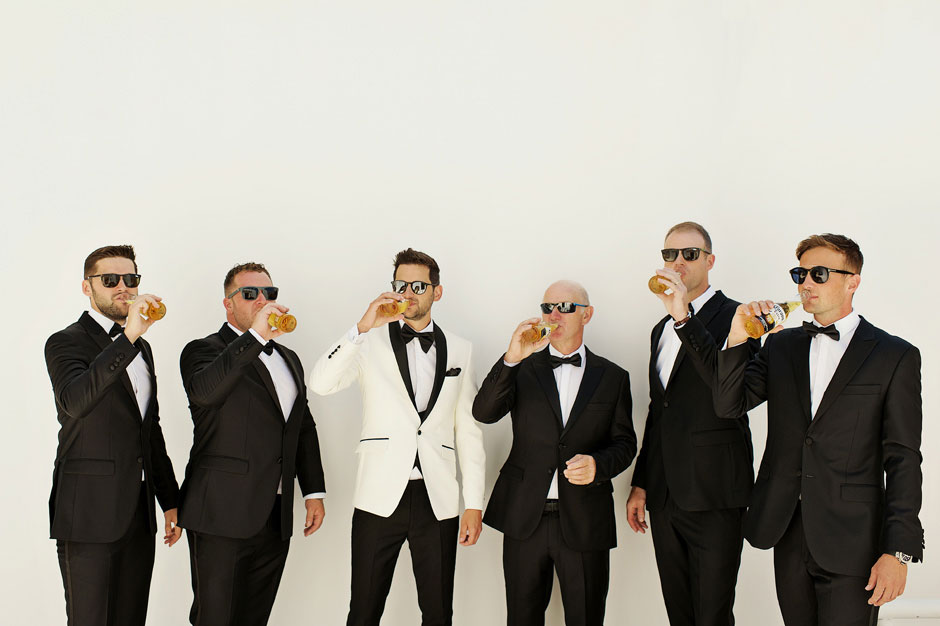 groom with groomsmen drinking beer