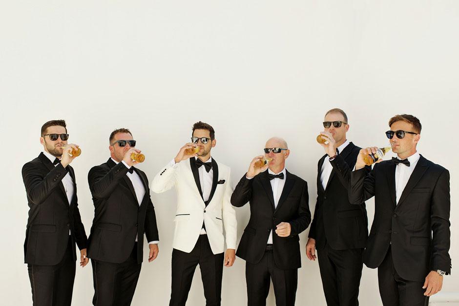 groom with groomsmen drinking beer