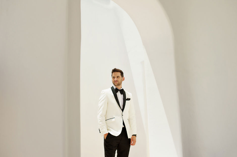 groom with white tuxedo