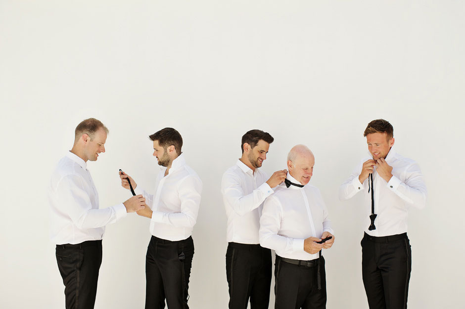 groomsmen wearing bow tie in mykonos