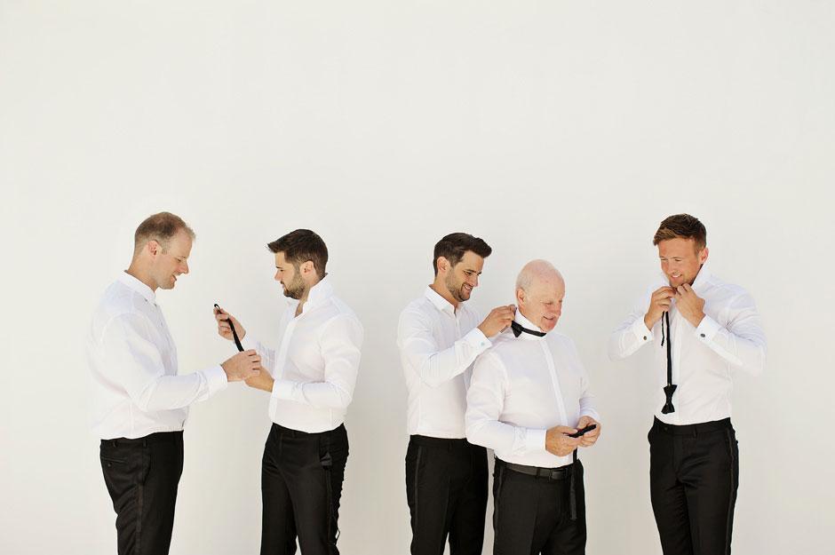 groomsmen wearing bow tie in mykonos wedding