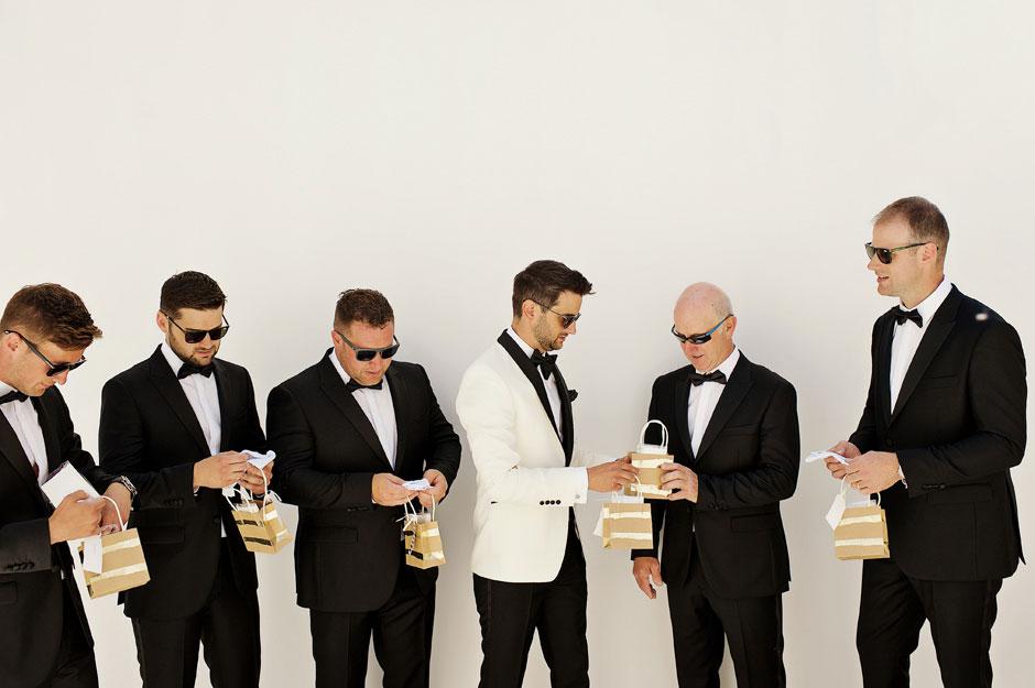 groomsmen receive presents from groom in mykonos wedding