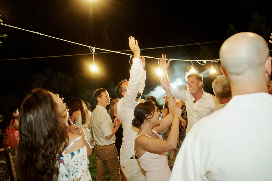 guests dancing in a greek beach