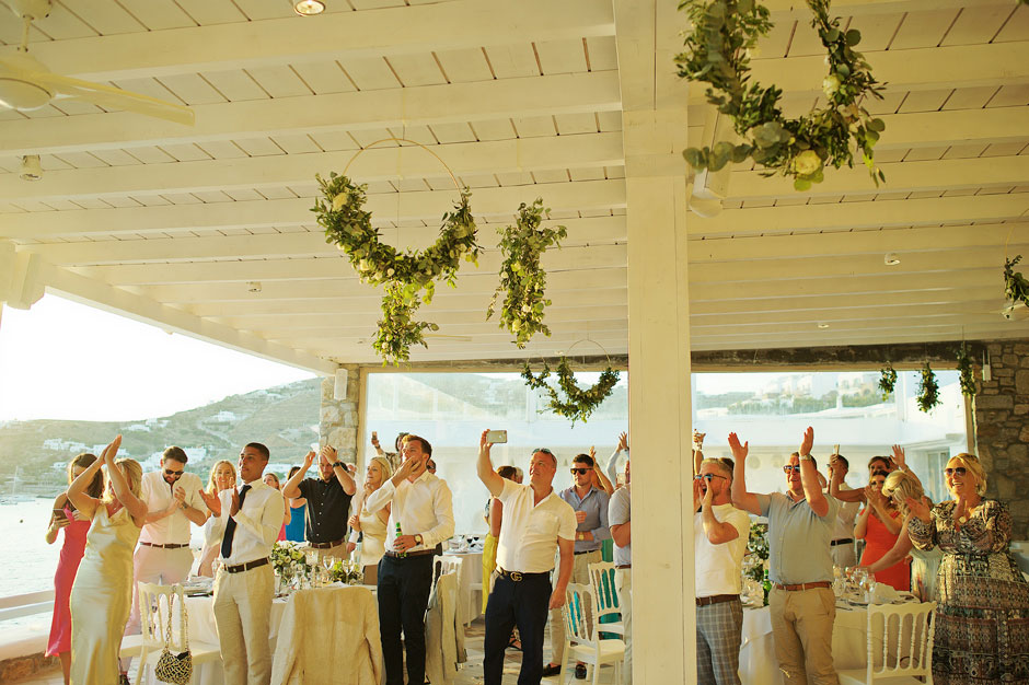 guests singing for the couple in mykonos wedding