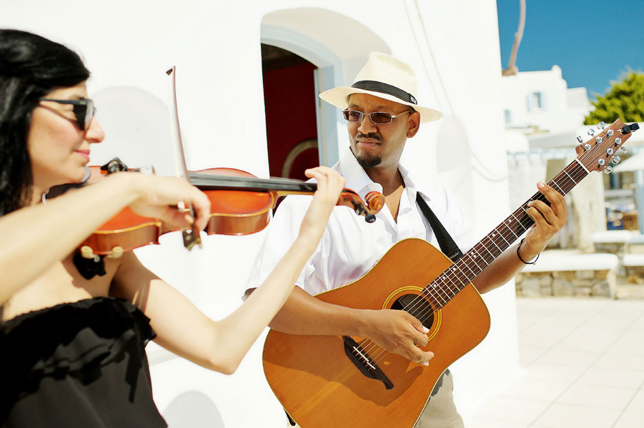 musician plays guitar during the elopement in mykonos