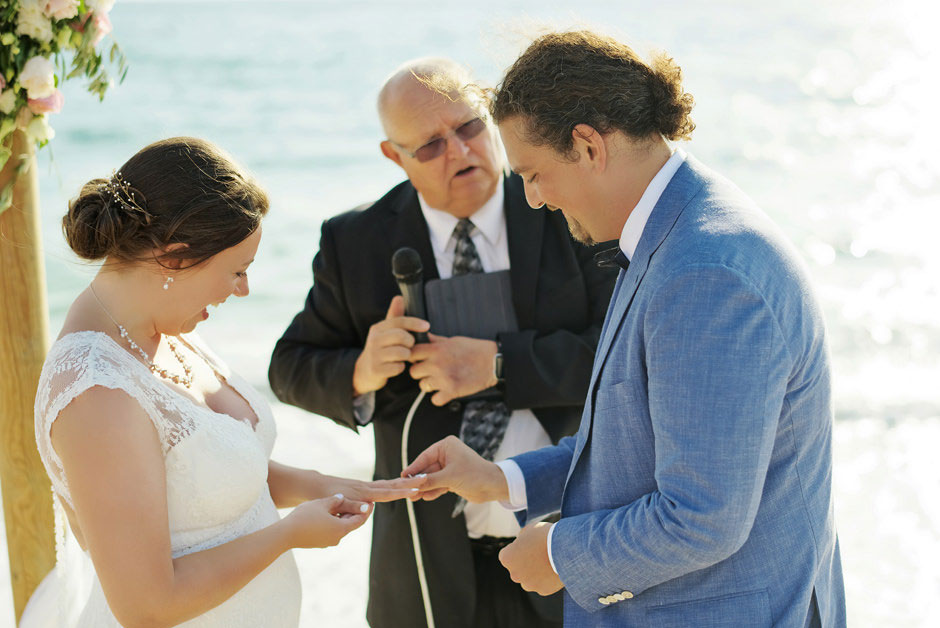 ring exchange on a beach wedding in naxos