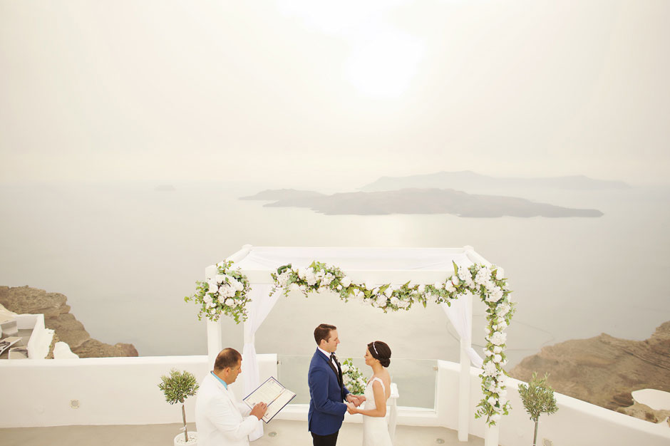 wedding-celebrant-starting-the-elopement-ceremony-in-santa-irini-wedding-venue-in-santorini