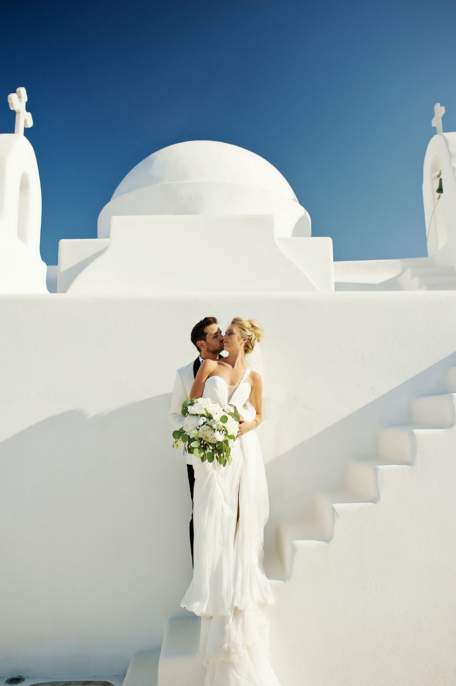 wedding couple in mykonos white church