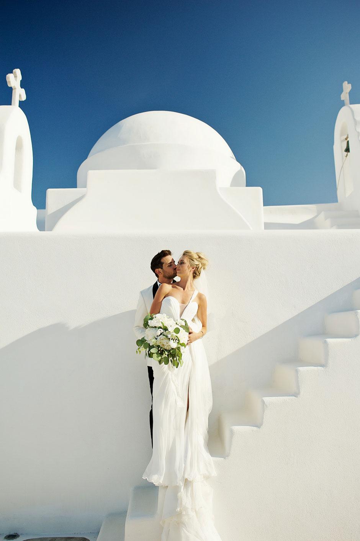 wedding couple in mykonos white chapel
