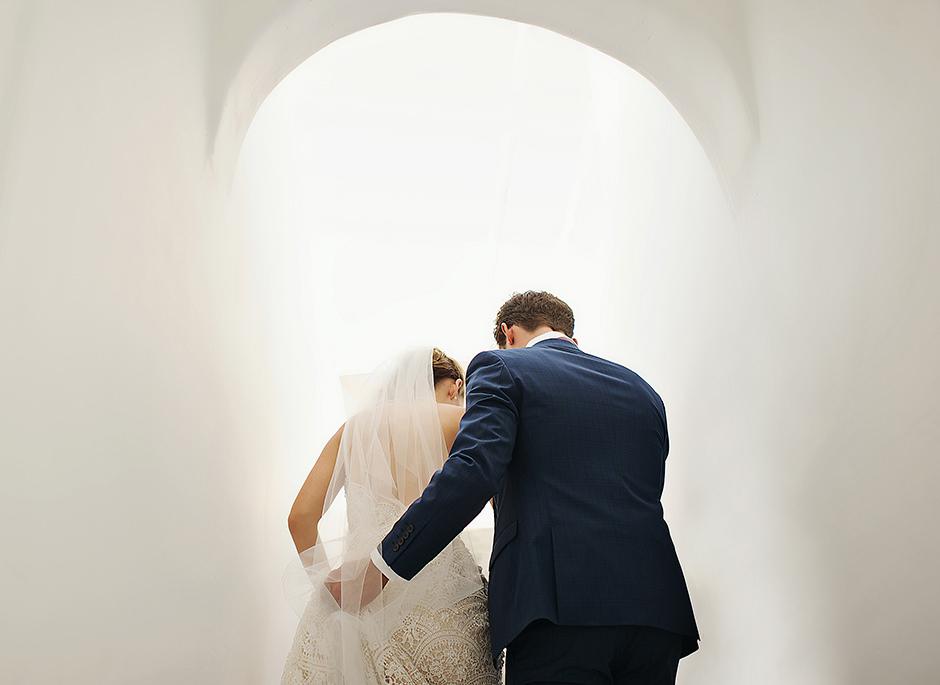wedding couple walking together in santorini