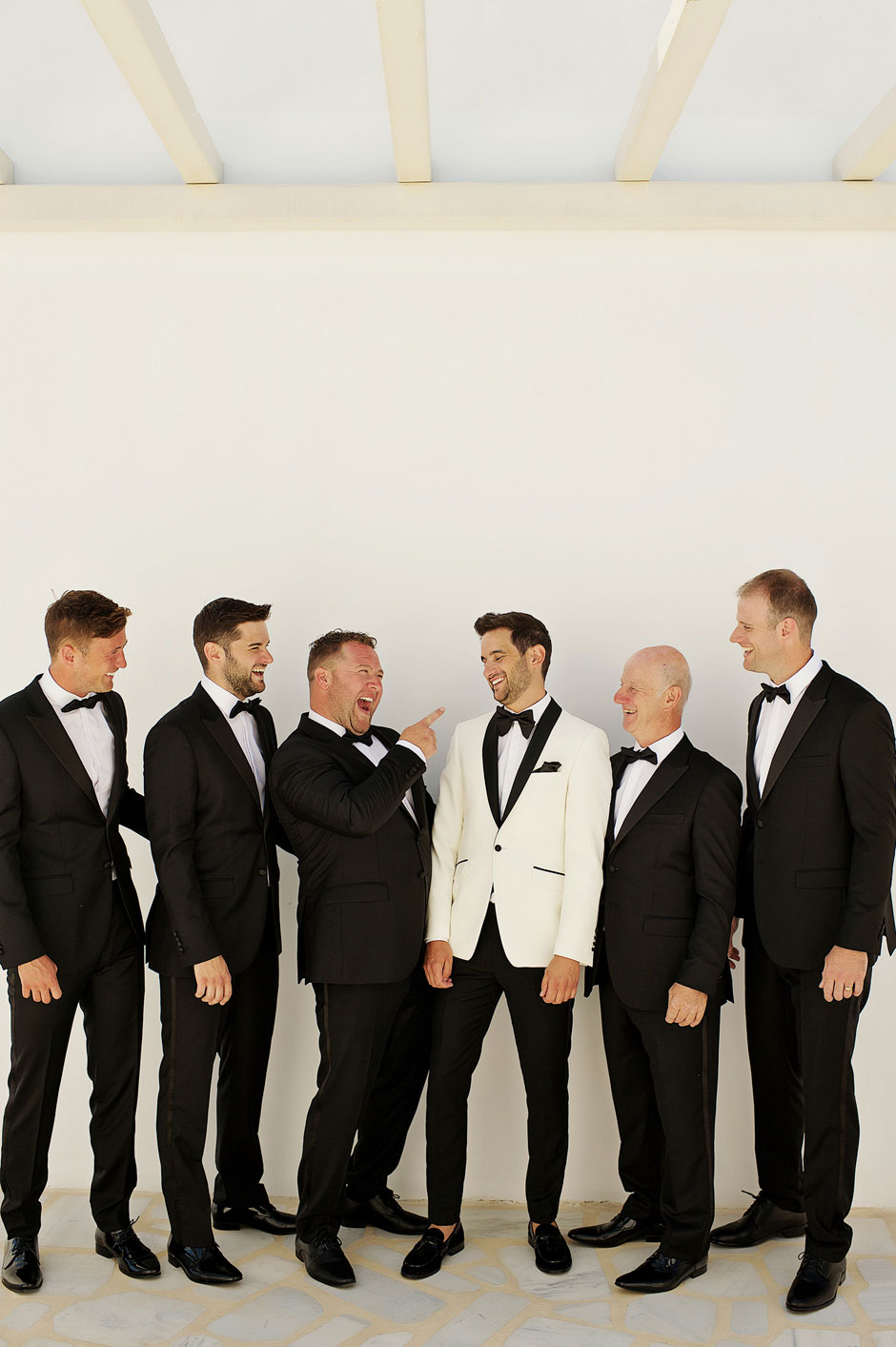 wedding in mykonos with groom and groomsmen