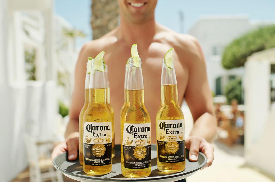 groom in mykonos wedding holding drinks
