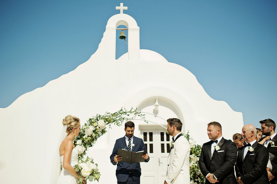 wedding officiant in mykonos starts the ceremony