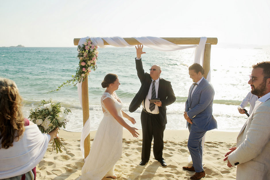 wedding officiant starts the ceremony in naxos