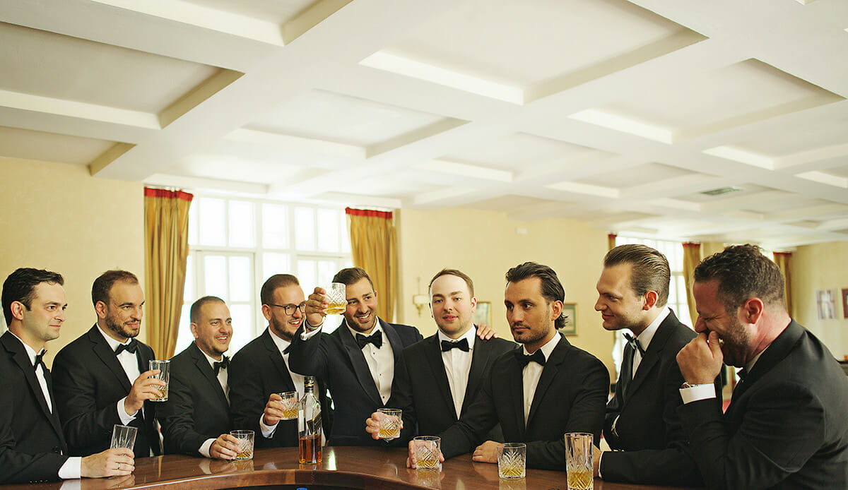 groom with best man in their black tuxedos